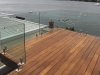 FRAMELESS-GLASS-BALUSTRADE-WITH-MARINE-GRADE-316-STAINLESS-STEEL-DECK-MOUNTED-SPIGOTS