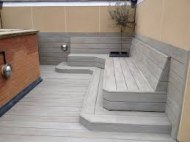 millboard smoked oak bench seating around hot tub.jpg
