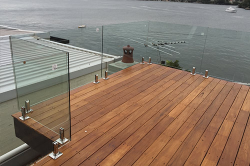 Frameless glass balustrade with marine grade 316 stainless steel deck mounted spigots.
