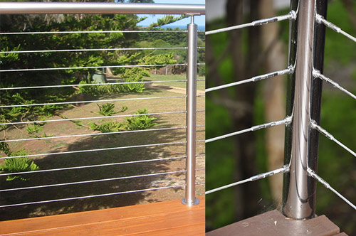 Stainless steel modular handrail and posts with stainless steel tension wires.